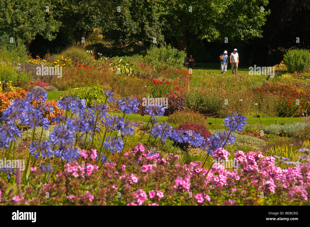 The Gardens with visitors at Bressingham museum in Norfolk Uk - Stock Image