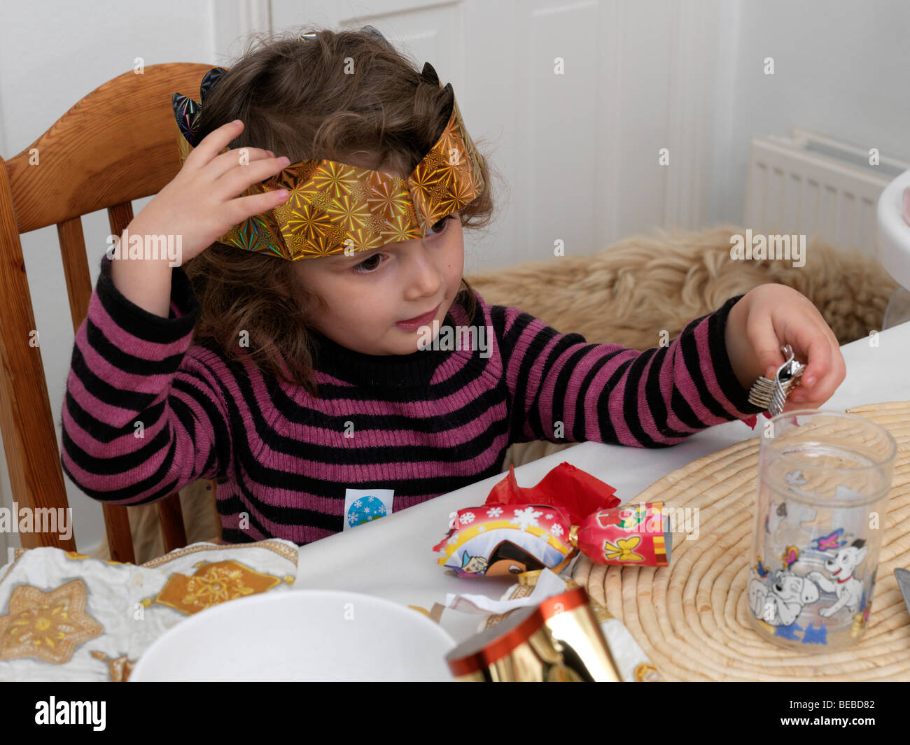 437c3845d2adb Four Year Old Girl With Paper Crown from a Cracker at Christmas - Stock  Image
