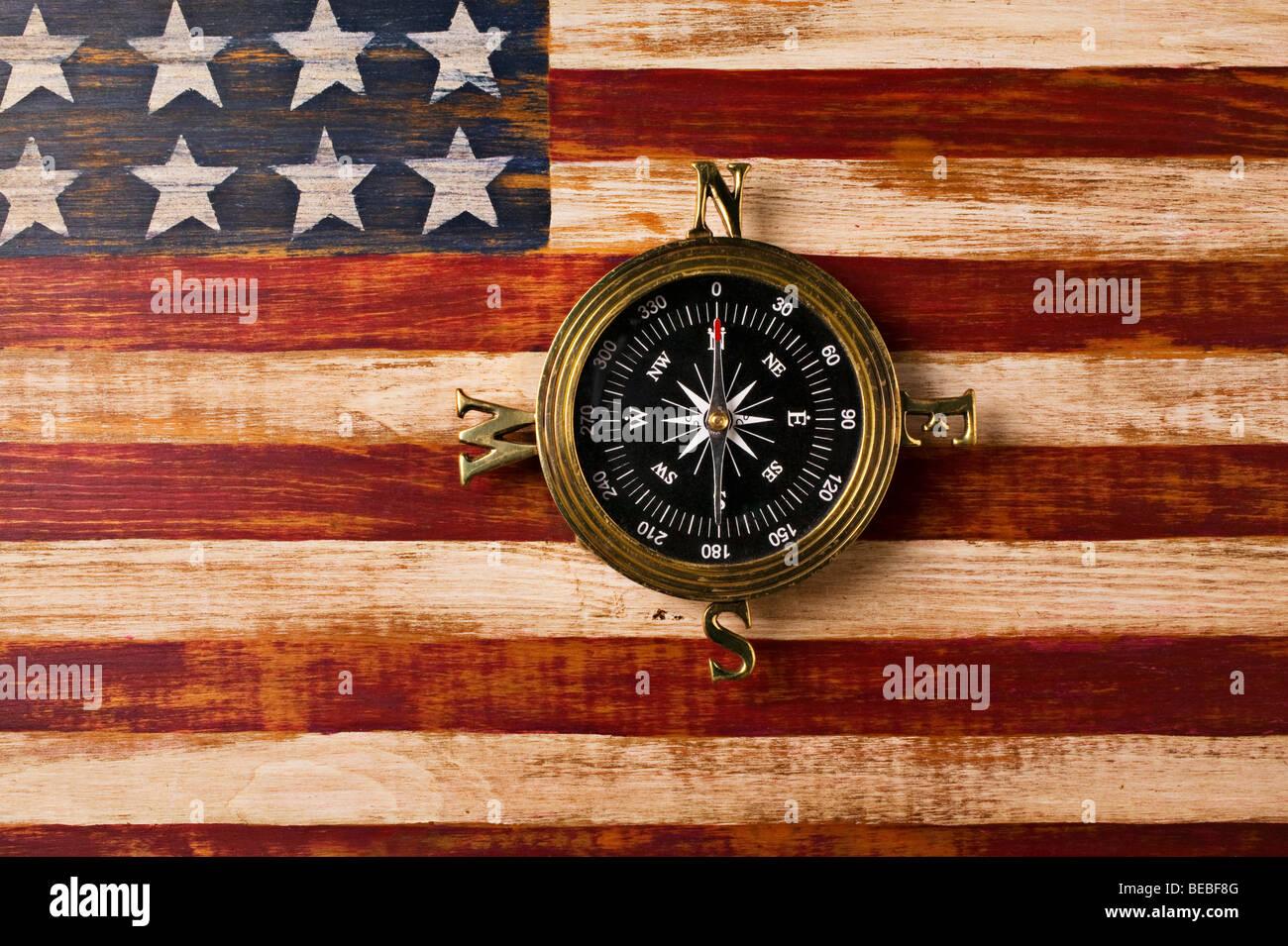 Compass on wooden folk art flag - Stock Image