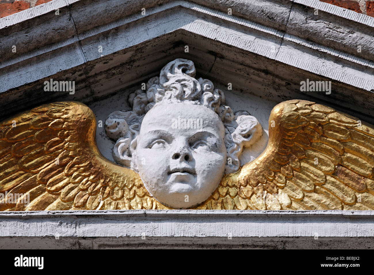 Angel head with golden wings, Renaissance portal of a city palace from the 17th century, Hoorn, Province of North - Stock Image
