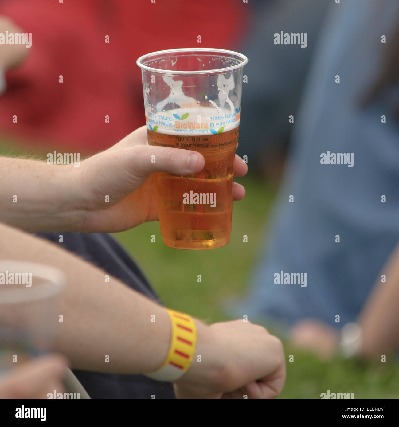 people drinking beer from BIOWARE Bio-degradable plastic glass at the Abergavenny food festival, Monmouthshire south - Stock Image