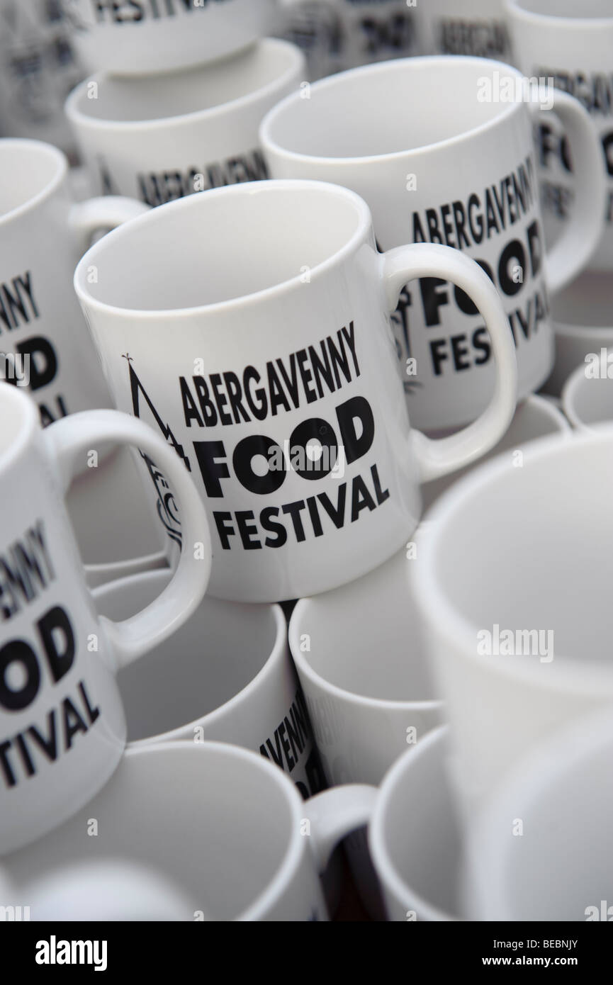 White souvenir promotional coffee mugs for sale - a memento of the Abergavenny food festival, Monmouthshire south - Stock Image