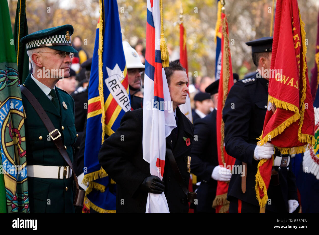 Members of the British services hold their colours at Sunderland Cenotaph during the Remembrance Day ceremony. - Stock Image