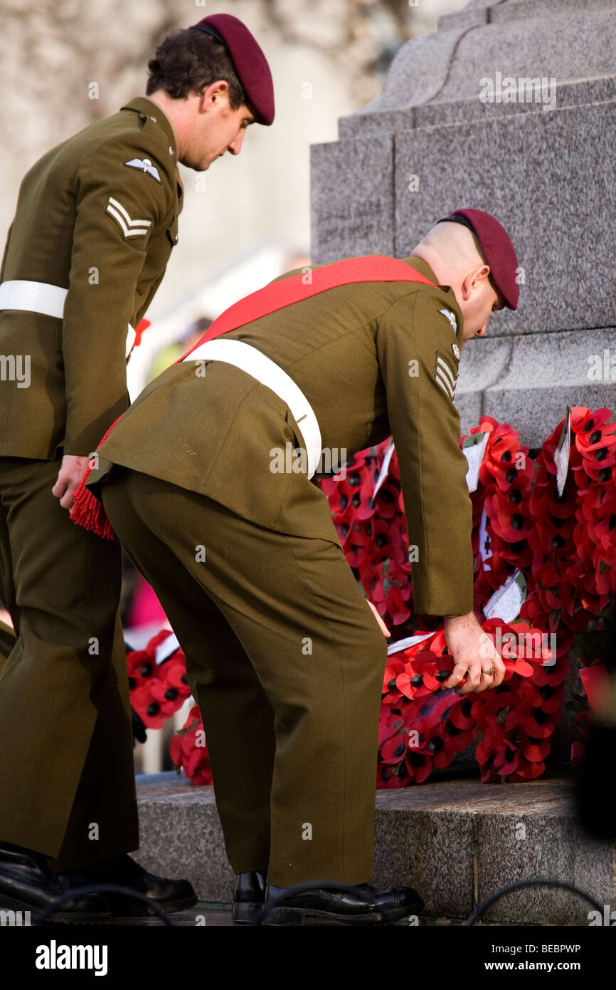 British soldiers, members of the Paratroop Regiment, lay a wreath at Sunderland Cenotaph during the Remembrance - Stock Image