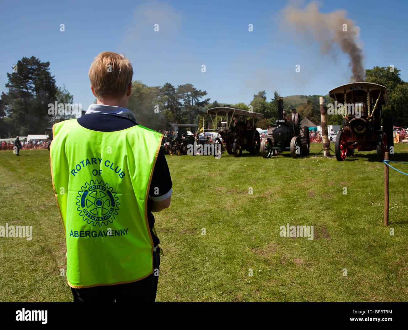Rotary Club official wearing jacket at Abergavenny Steam Fair Wales UK - Stock Image