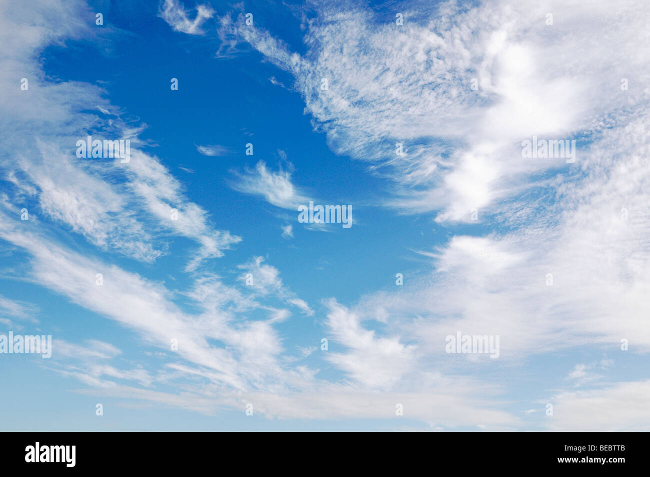 Cloud Filled Blue Sky - Stock Image