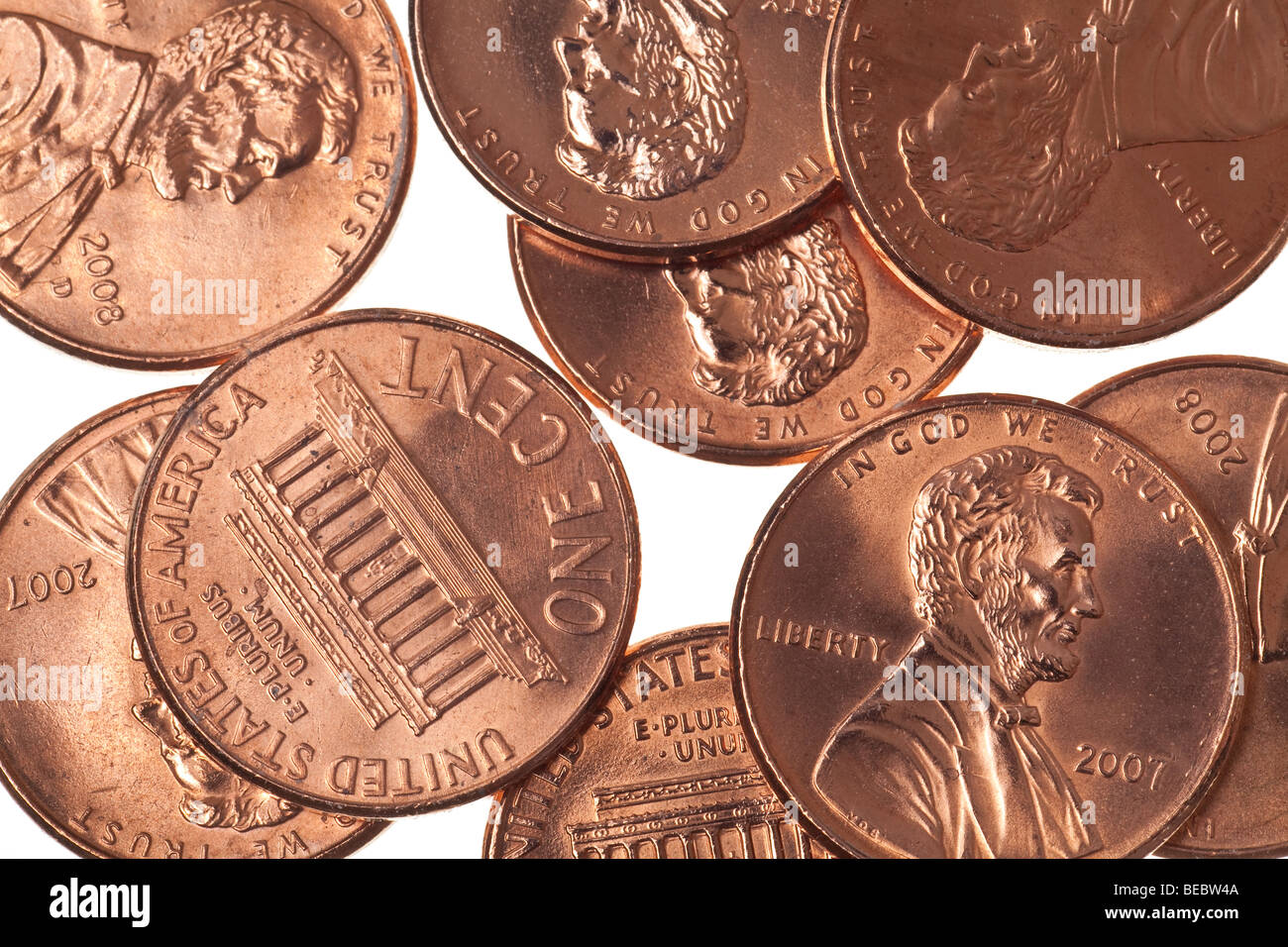 pennies isolated on a pure white background - Stock Image