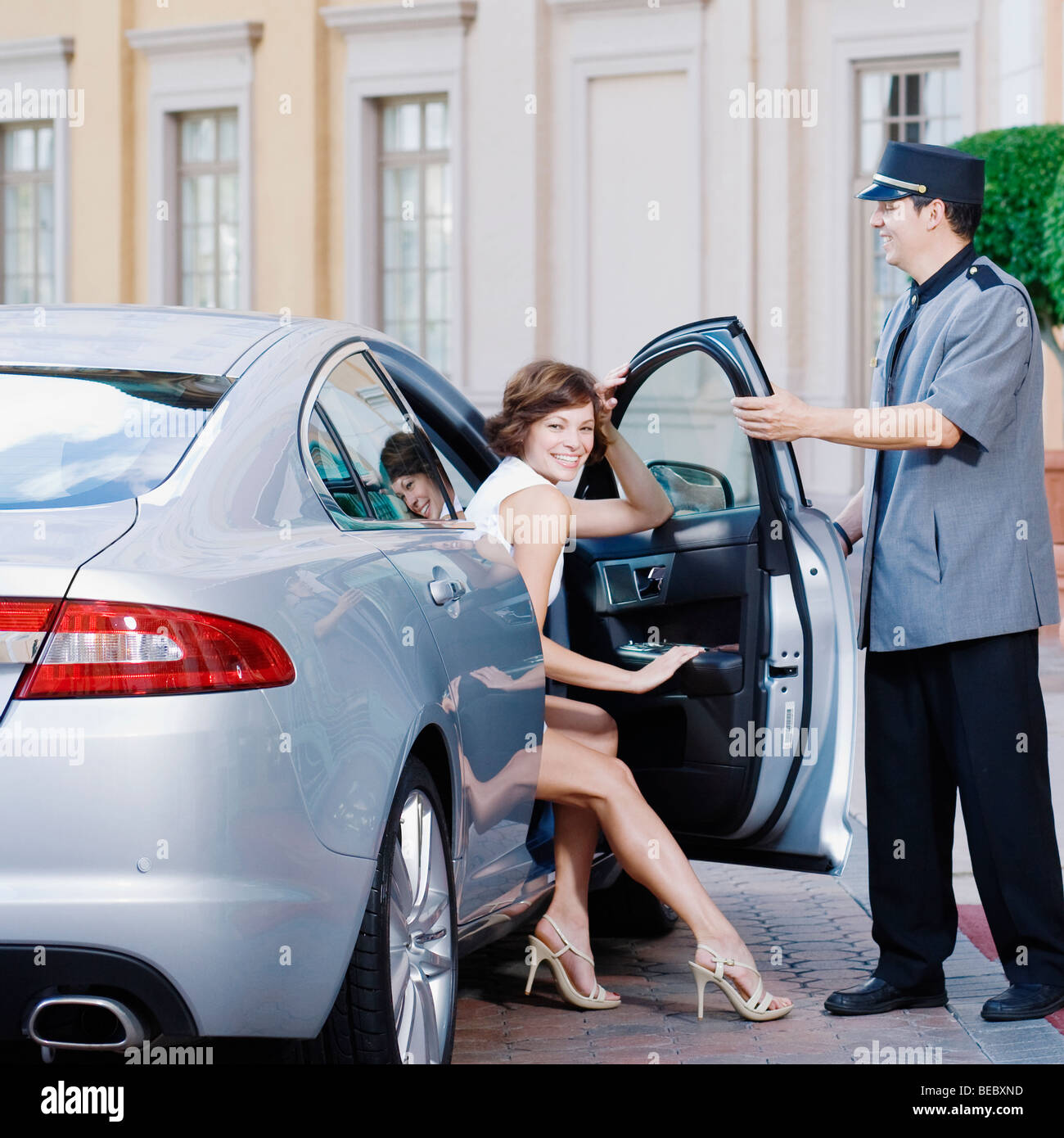 Hotel Porter Opening Car Door For A Woman Biltmore Hotel Coral