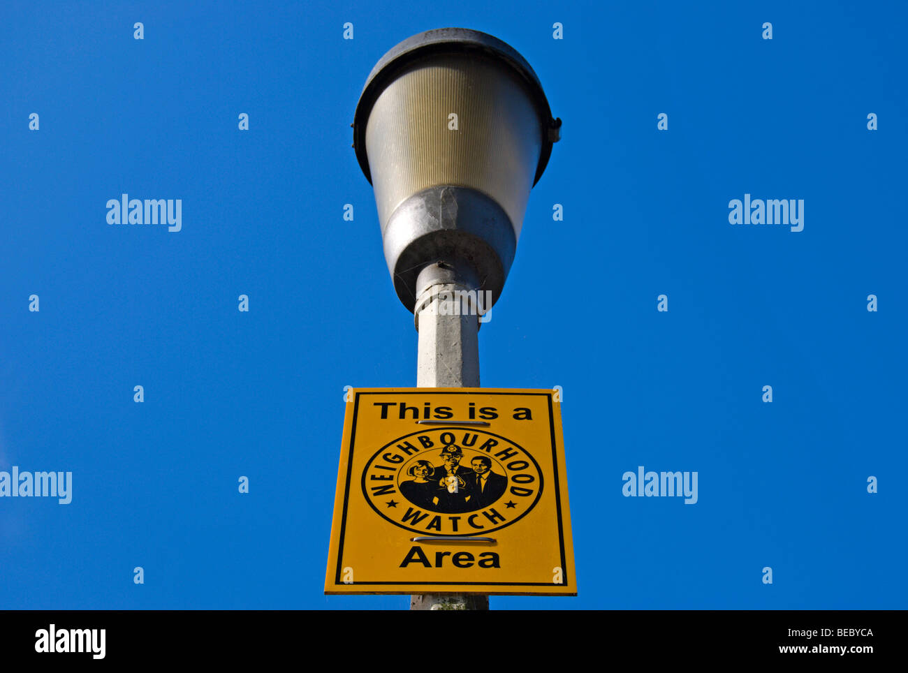 this is a neighbourhood watch area sign fixed to a lamppost in bedford park, chiswick, west london, england - Stock Image