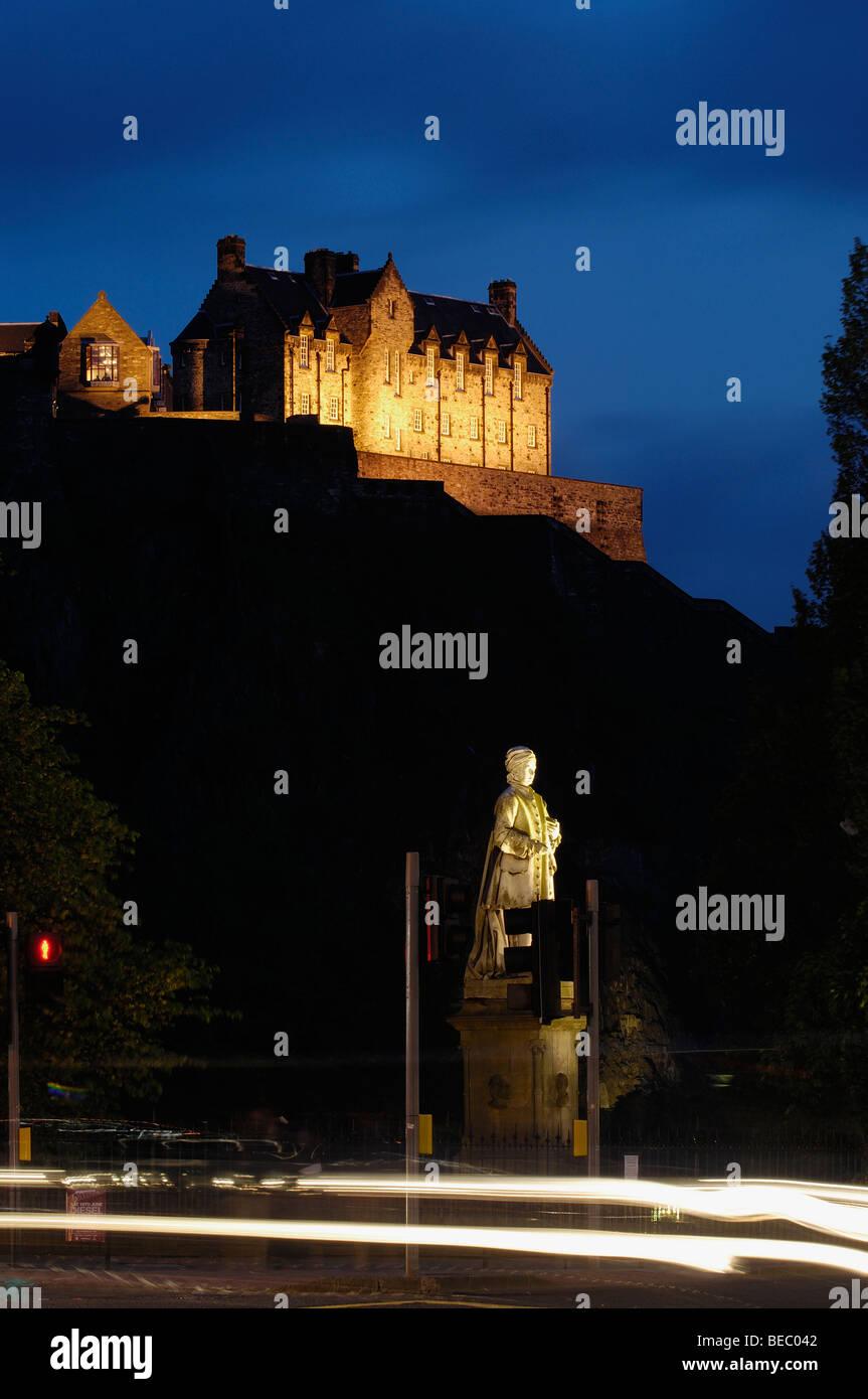 Statue of Allan Ramsay and Edinburgh Castle at background from Princes street at Dusk. Edinburgh. Scotland. U.K. Stock Photo