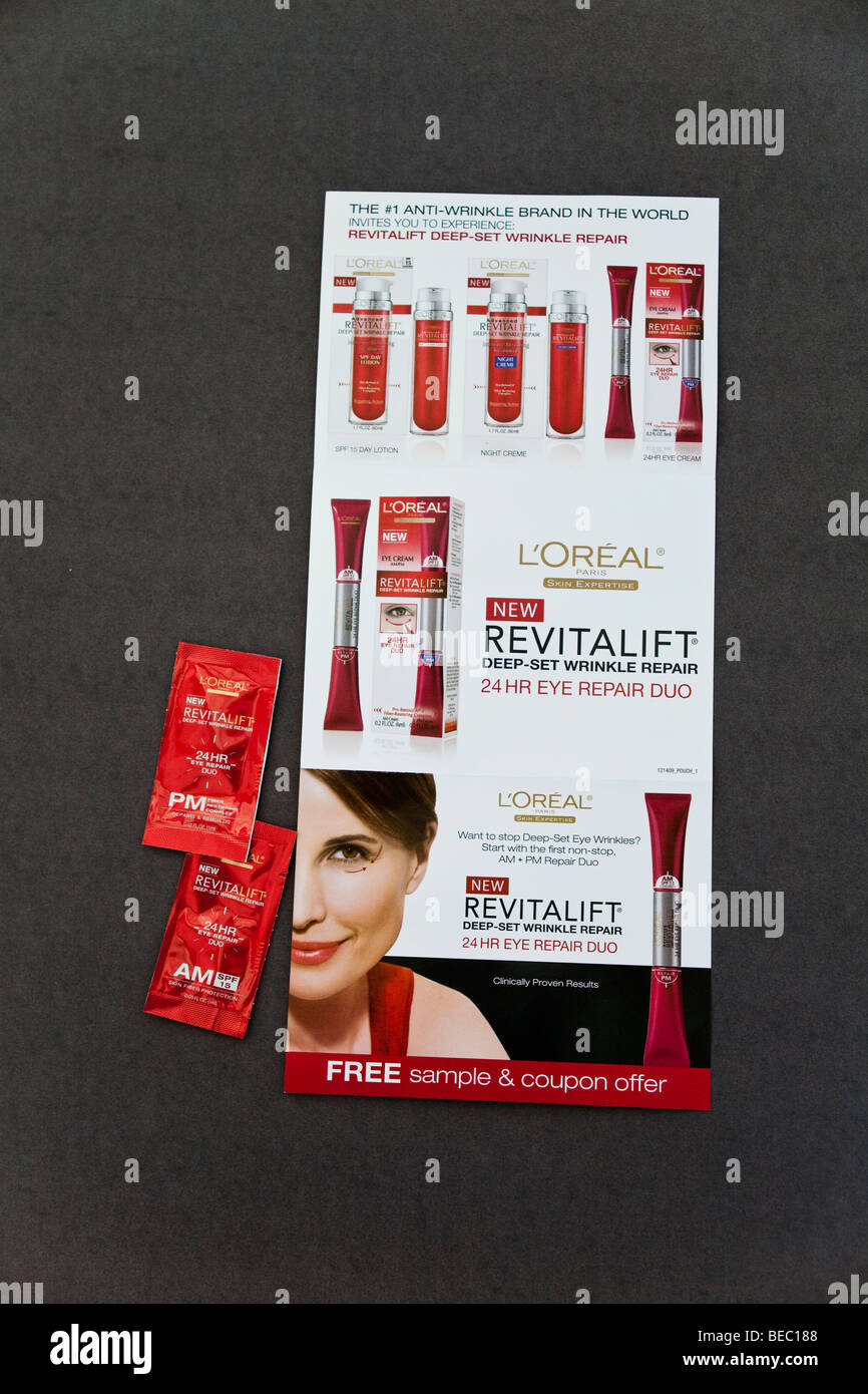 Free sample of Loreal skincare product sent out with Sunday newspaper. © Myrleen Pearson - Stock Image