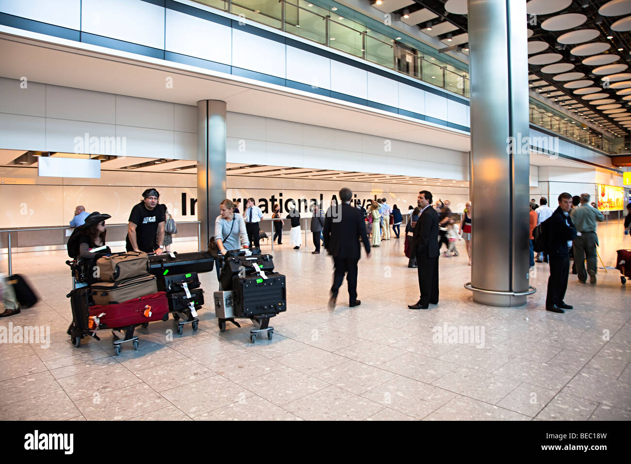 People at international arrivals Heathrow airport London England UK - Stock Image