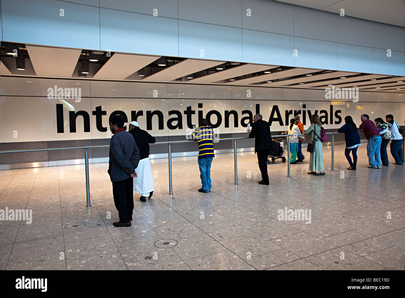 People waiting for international arrivals Heathrow airport London England UK - Stock Image