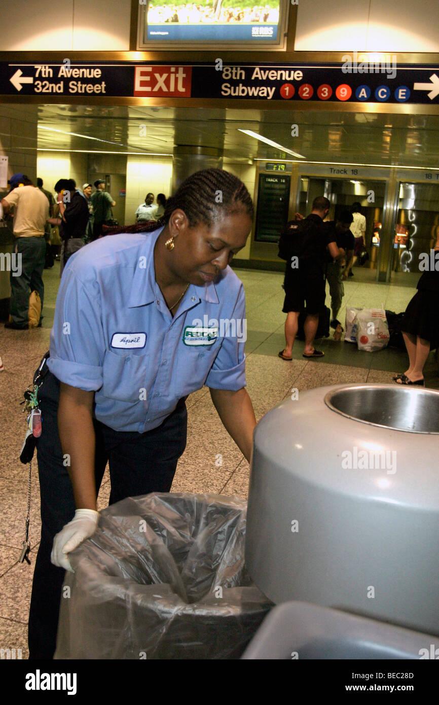 June, 2004, Custodial worker at Penn Station in New York City. - Stock Image
