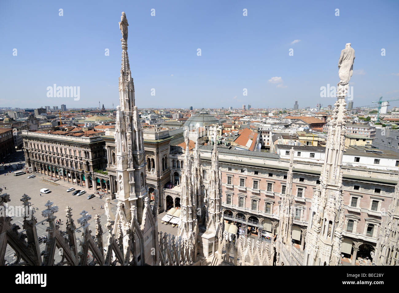 Milan skyline, from the roof of the cathedral, looking out north west over the square (Piazza del Duomo), Lombardy, - Stock Image