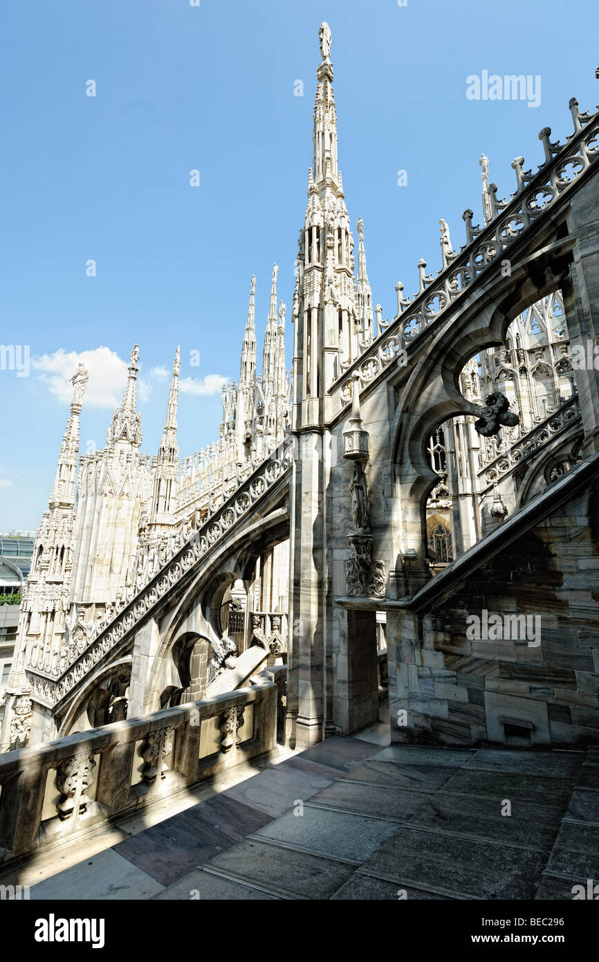 Flying buttress supporting the roof of Milan cathedral, with statues on top of spires, Lombardy, Italy Stock Photo