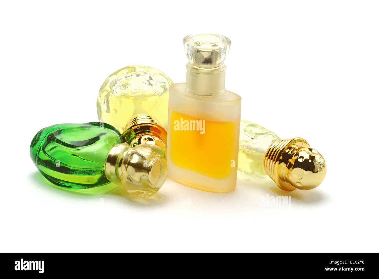 Four bottles of perfume on white background Stock Photo