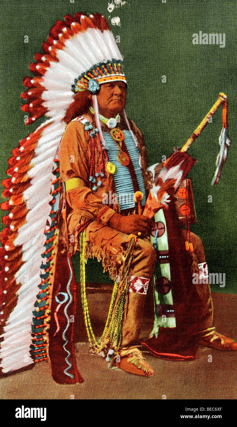 Seated here in full dress is an Osage Indian, believed to be Chief Pahsetopah. - Stock Image