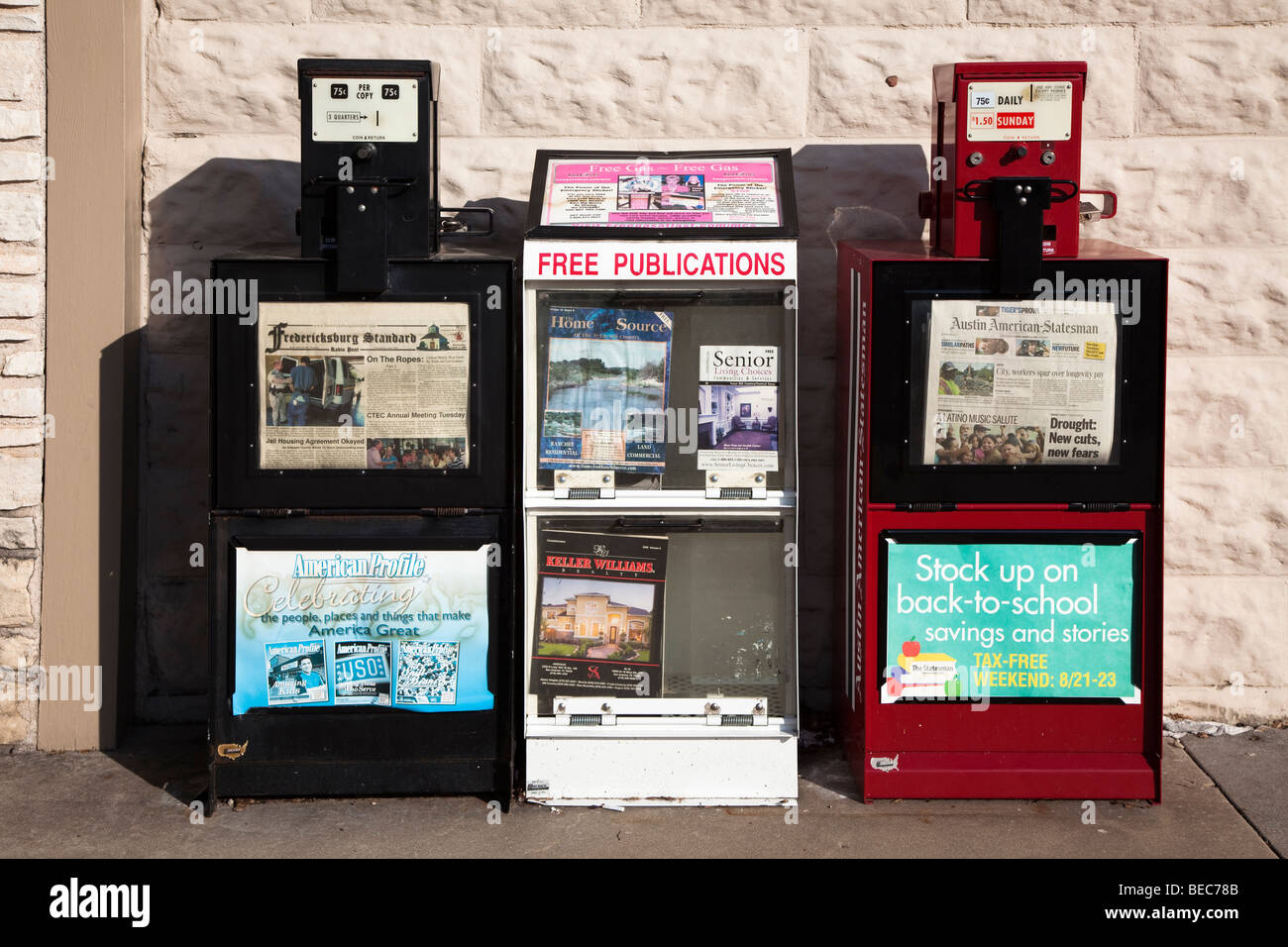Newspaper paid and free publication stands Fredericksburg Texas USA - Stock Image