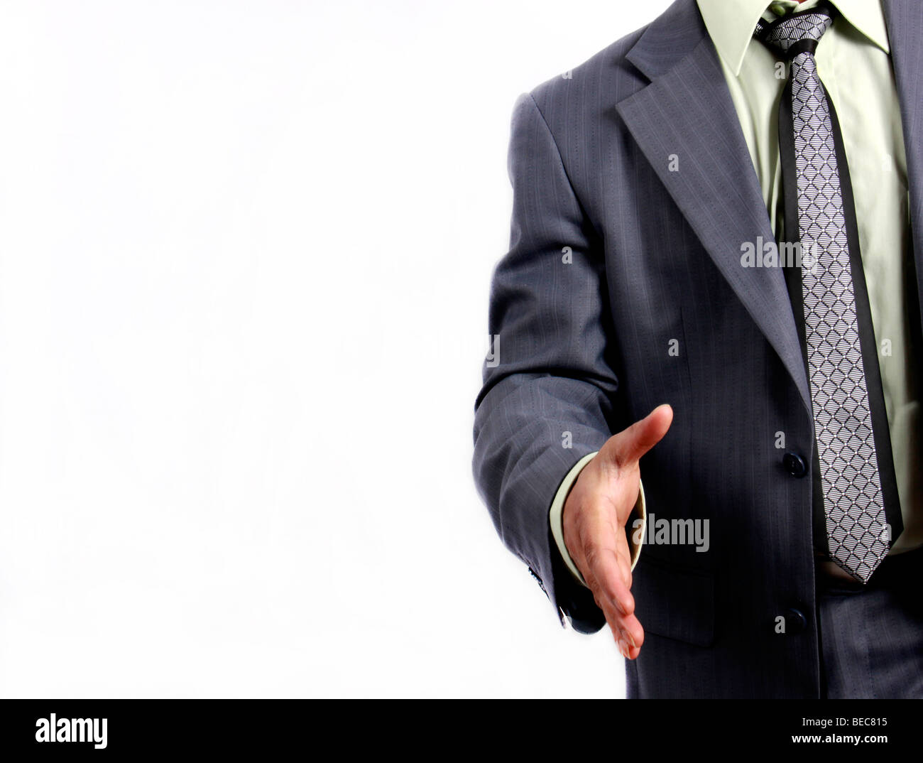 Businessman handshake welcoming - Stock Image