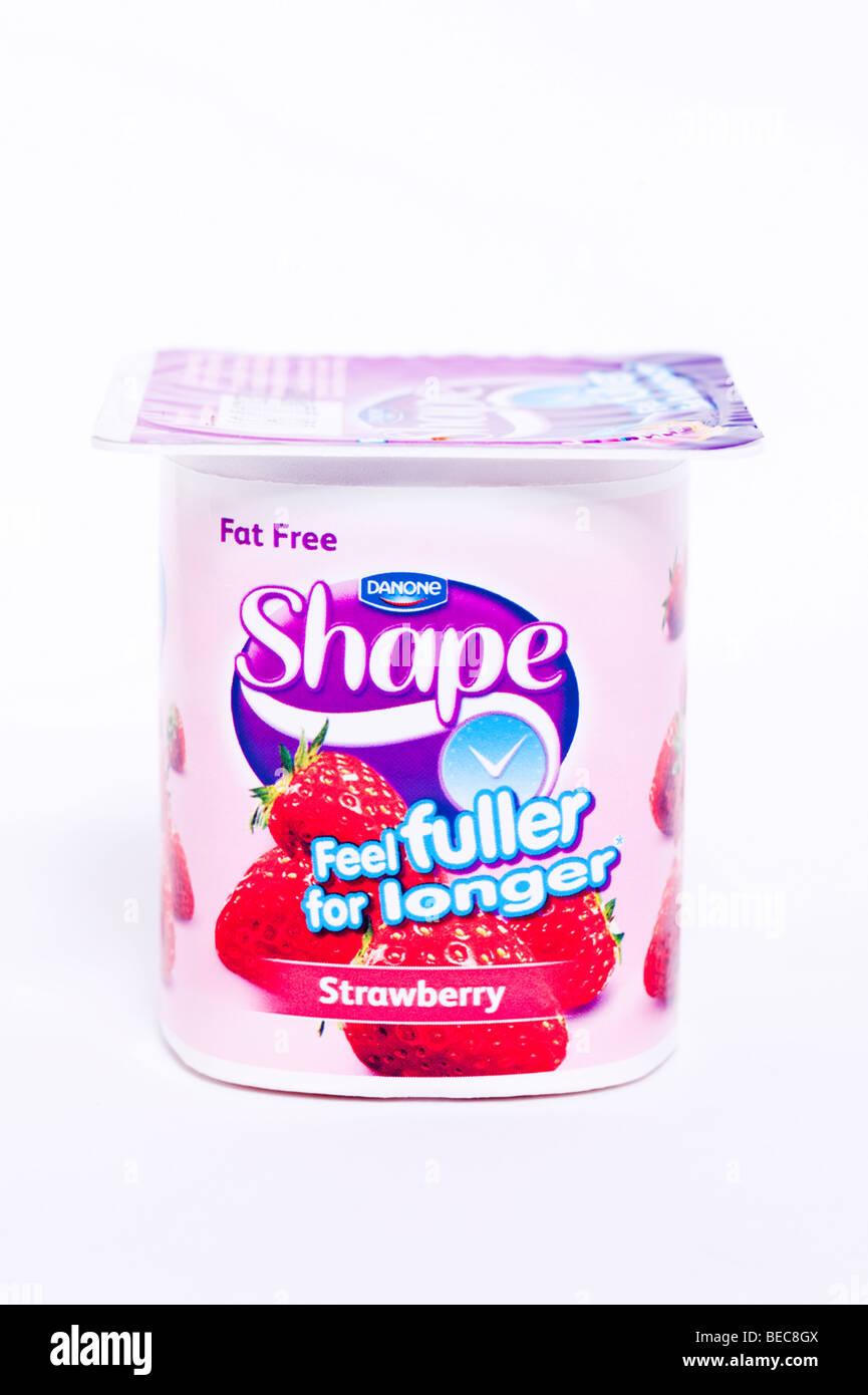 A Danone Shape fat free strawberry yoghurt on a white background Stock Photo