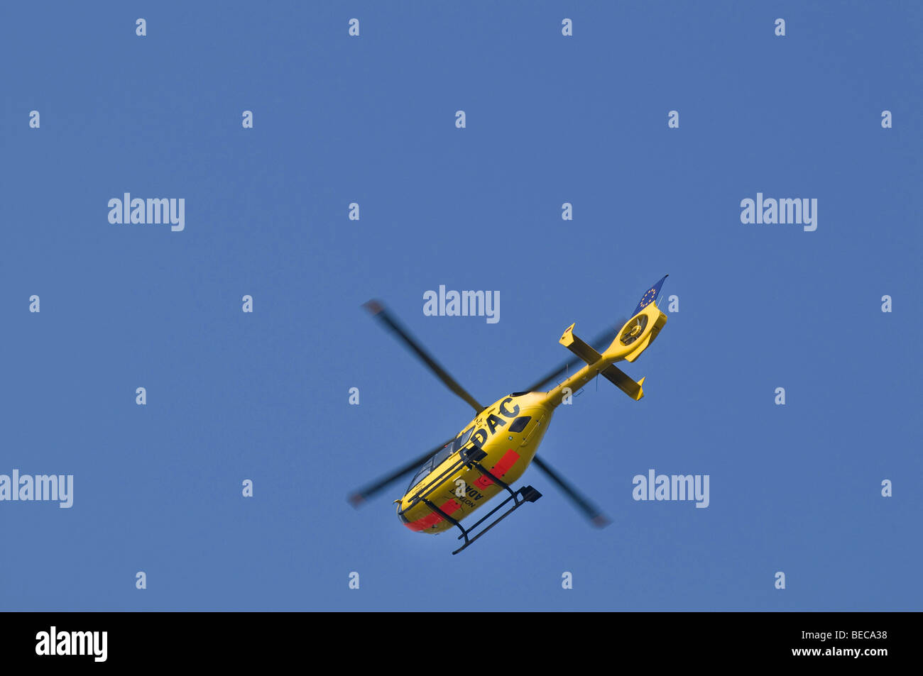 Air rescue helicopter from the ADAC Luftrettung GmbH, ambulance helicopter, Christoph 20 in flight seen from below - Stock Image