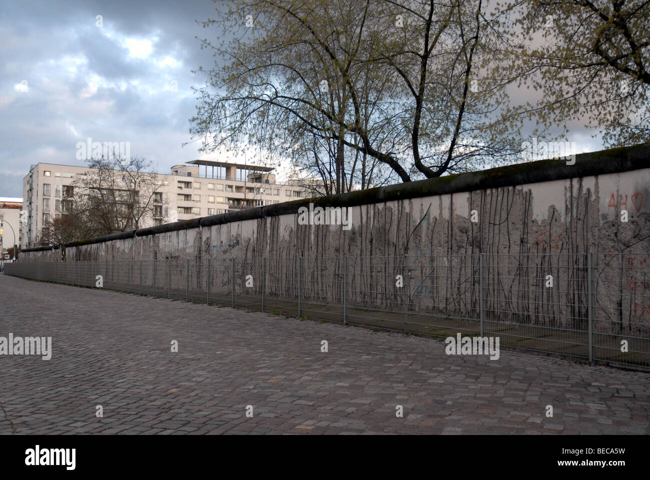 Preserved section of the Berlin Wall on Niederkirchnerstrasse, formerly Prinz-Albrecht-Strasse, Berlin, Germany. - Stock Image