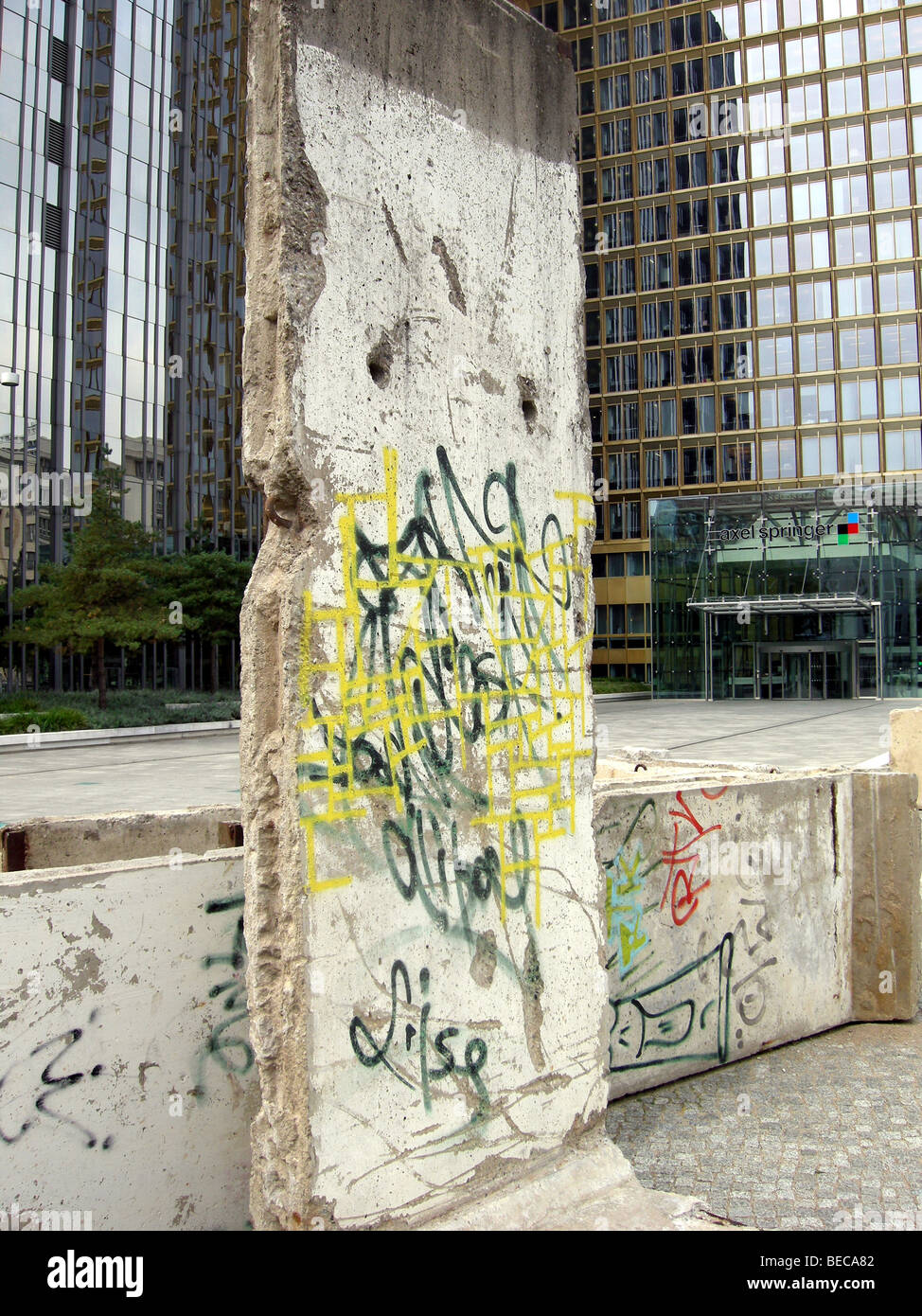 Preserved section of the Berlin Wall on Kommandanten Strasse, Berlin, Germany. Part of the wall is left next to - Stock Image
