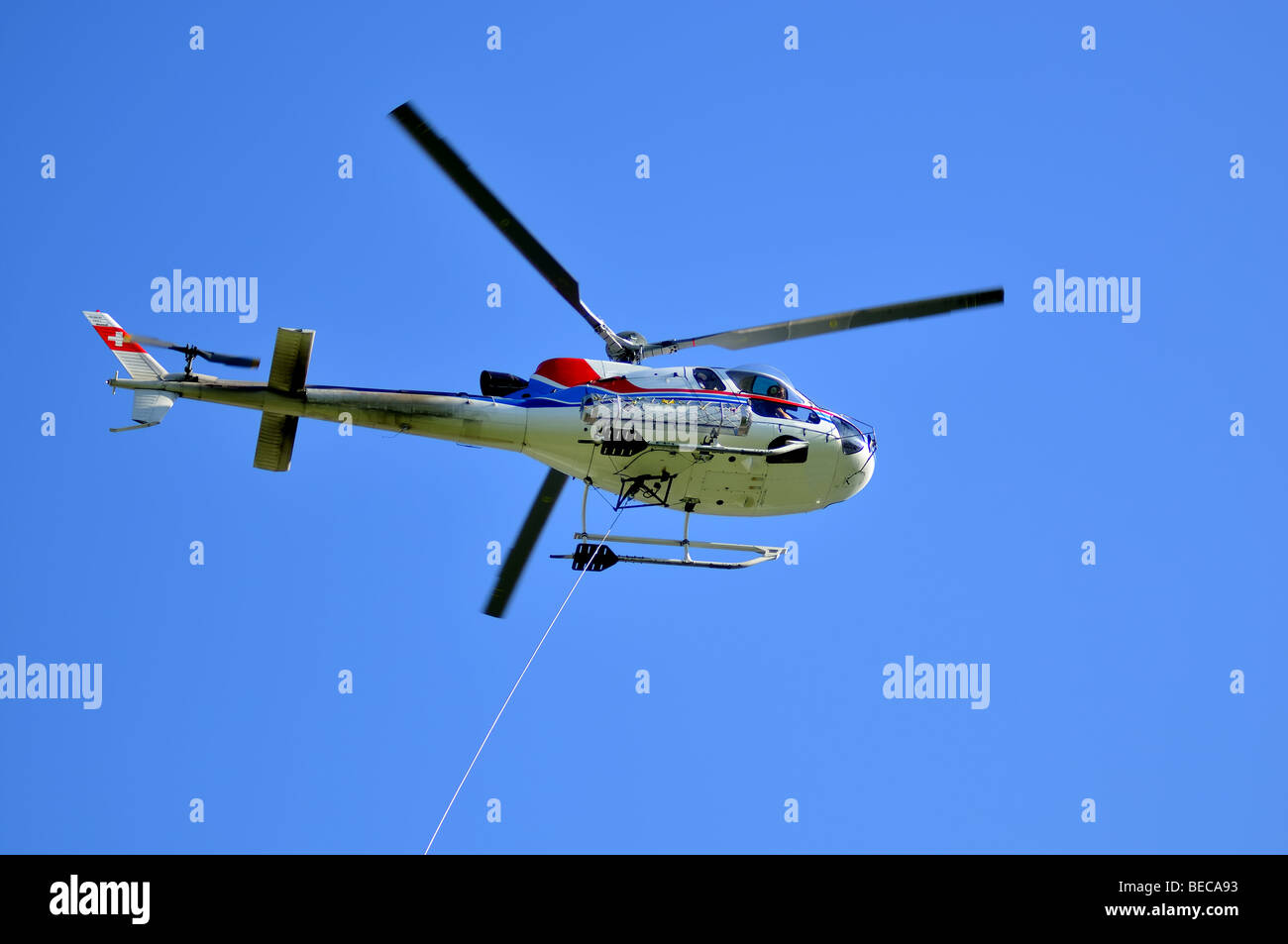 helicopter and tow cable Stock Photo