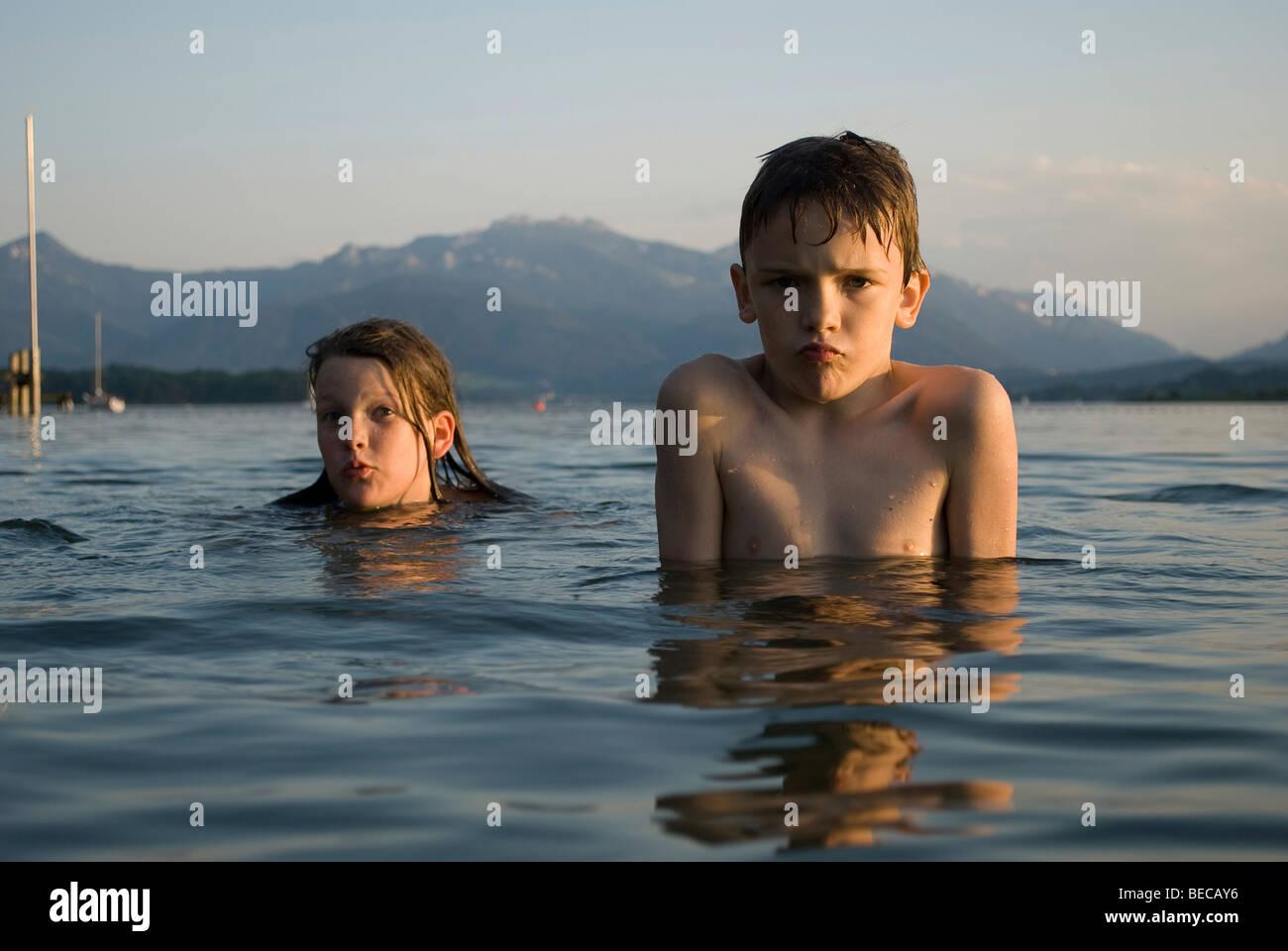Children swimming in Lake Chiemsee, Bavaria, Germany, Europe - Stock Image