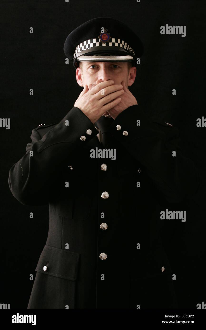 British Policeman on plain background Stock Photo