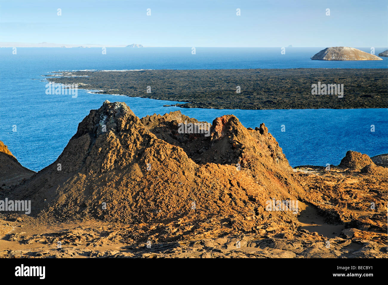 Primeval volcanic scenery with small crater, Bartolomé Island, view to Santiago, Galapagos Achipelago, UNESCO World Stock Photo