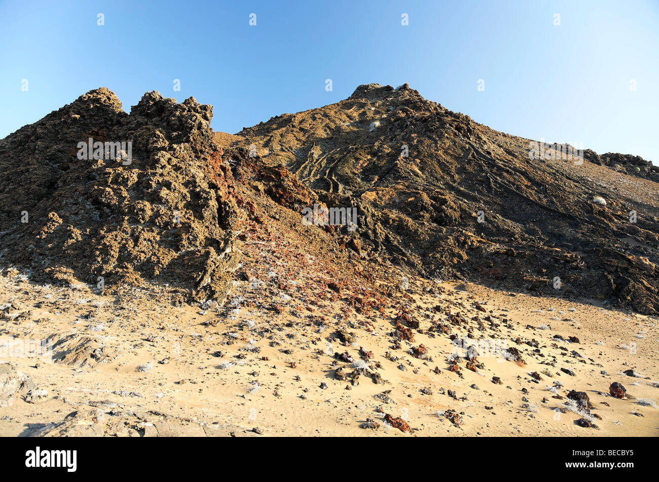 Two small volcanoes, volcanic rocks, lava drains, Bartolomé Island, Galapagos Achipelago, UNESCO World Heritage - Stock Image