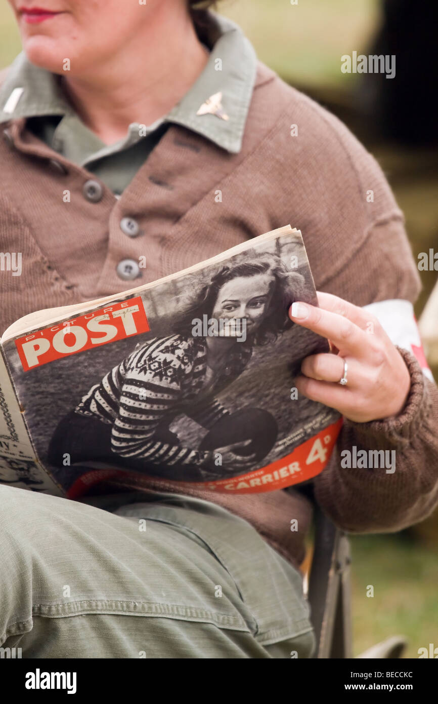 World War 2 Reenactor Reading Picture Post Magazine - Stock Image