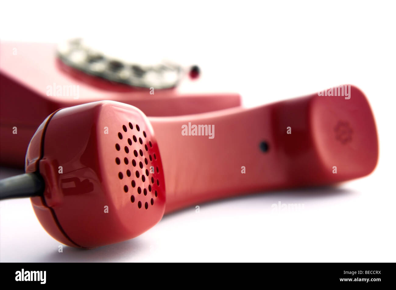 Detail of a red rotary telephone - Stock Image