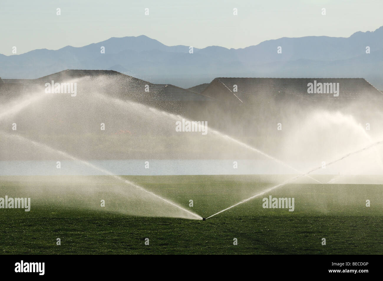 Reclaimed water is used to irrigate a golf course in the Sonoran Desert in Green Valley, Arizona, USA. - Stock Image