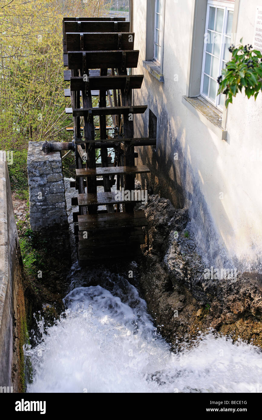 Water wheel powered by a creek - Stock Image