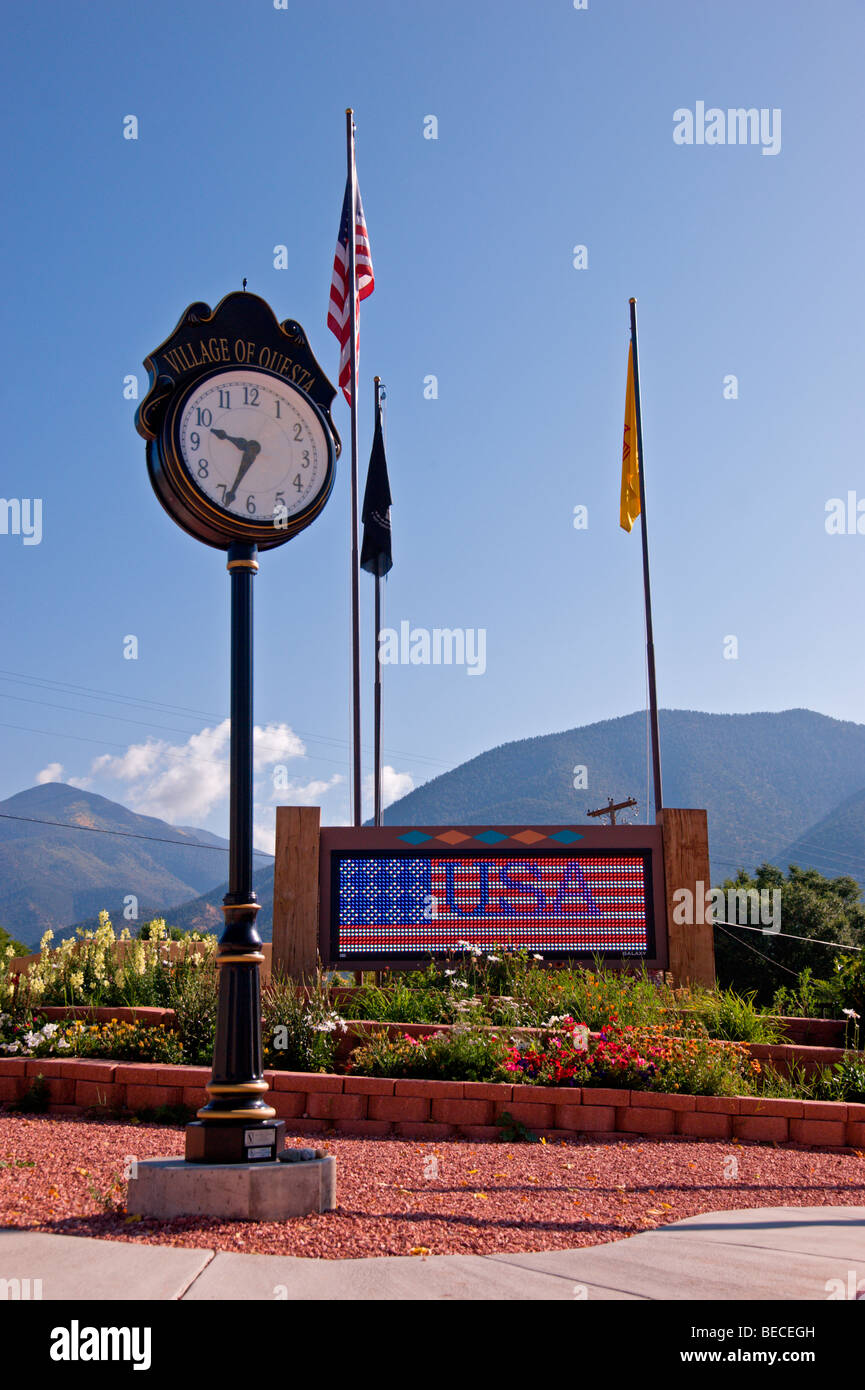 A towering timepiece stands tall in a memorial park in Questa, New Mexico. - Stock Image