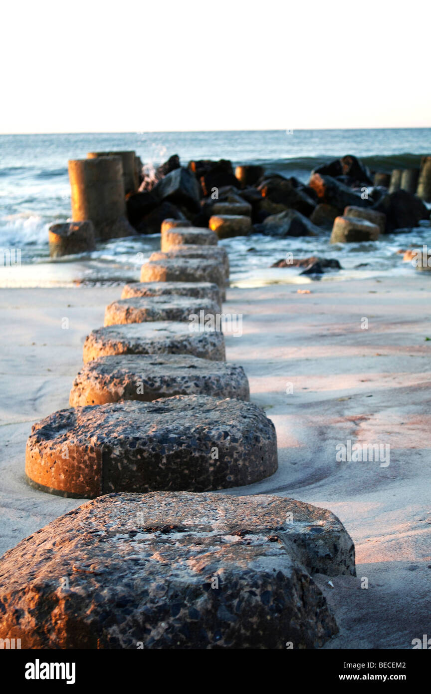 Rock Jetty on the beach in Fire Island - Stock Image