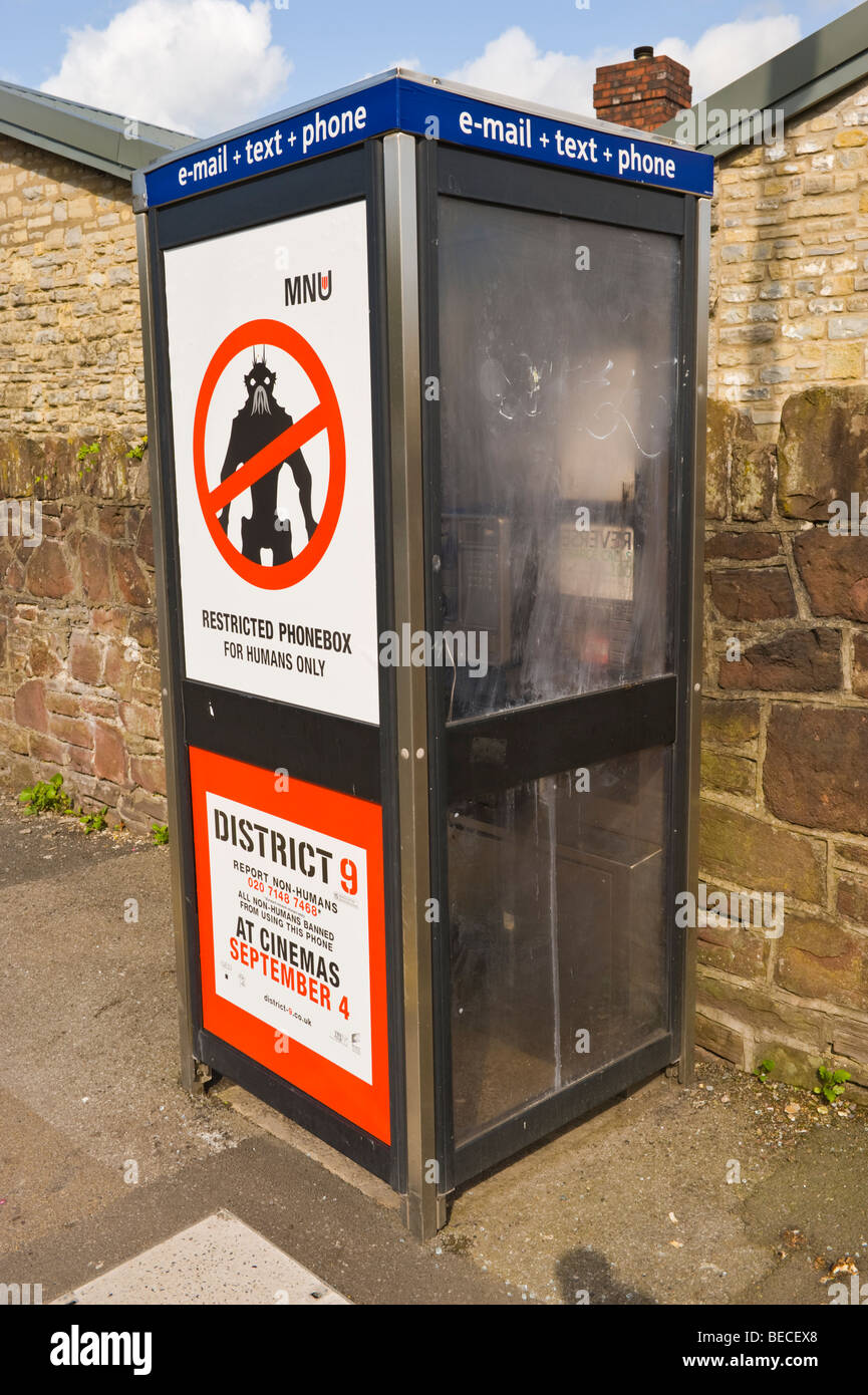 Billboard for cinema film on BT telephone box in UK - Stock Image