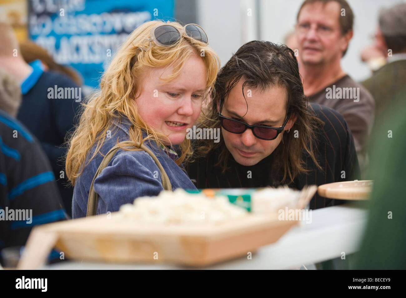 Selecting cheese at The Great British Cheese Festival Cardiff South Wales UK - Stock Image