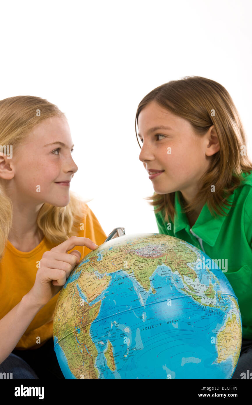 Two girls with a globe - Stock Image