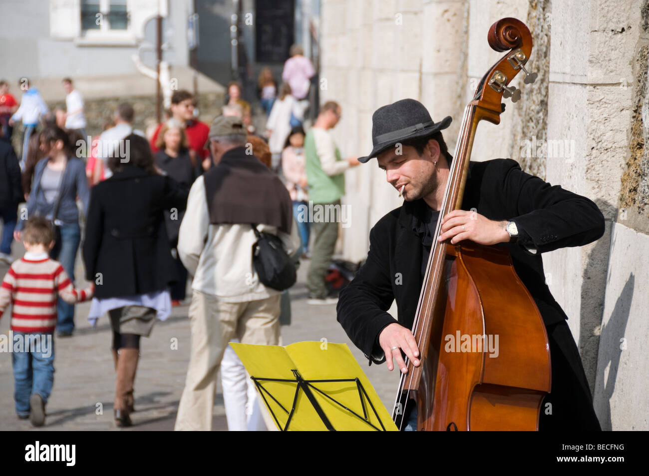 French street musician playing an upright bass in Paris. Stock Photo