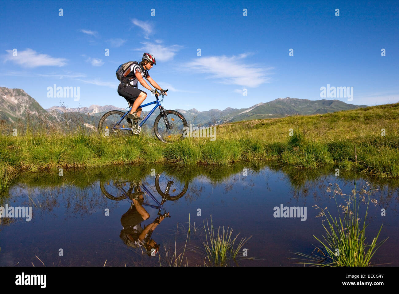 Mountainbiker on the shore of a mountain lake, Northern Tyrol, Austria, Europe Stock Photo