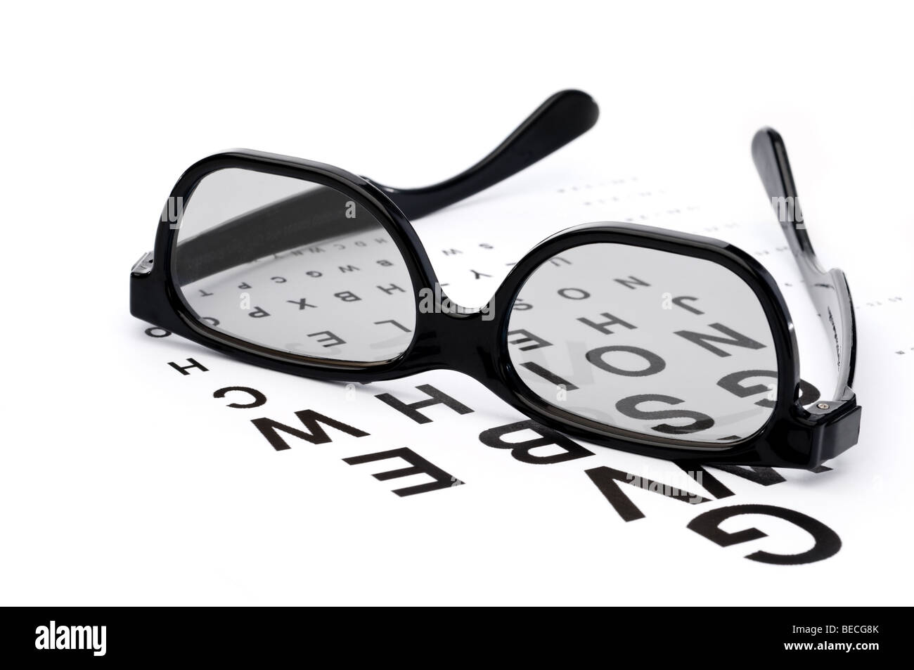 Horizontal image of eyeglasses on a eye exam chart - Stock Image