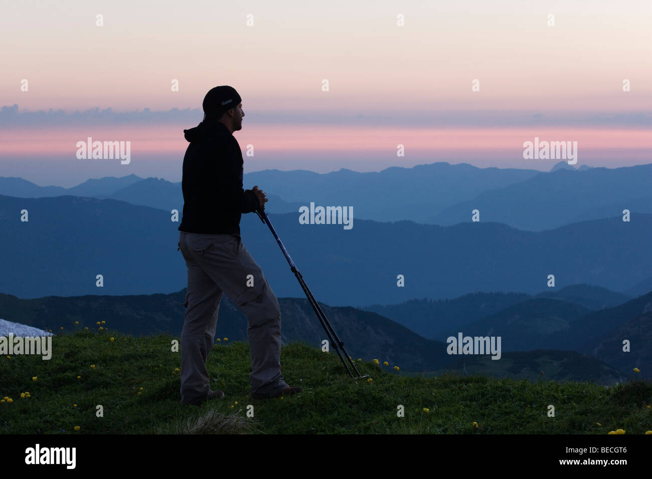 Hiker looking at mountains after sunset, Rofan Range, North Tyrol, Austria, Europe Stock Photo