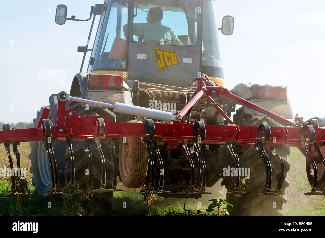 JCB Fastrac 1135 4-wheel drive tractor and soil harrow - France. - Stock Image