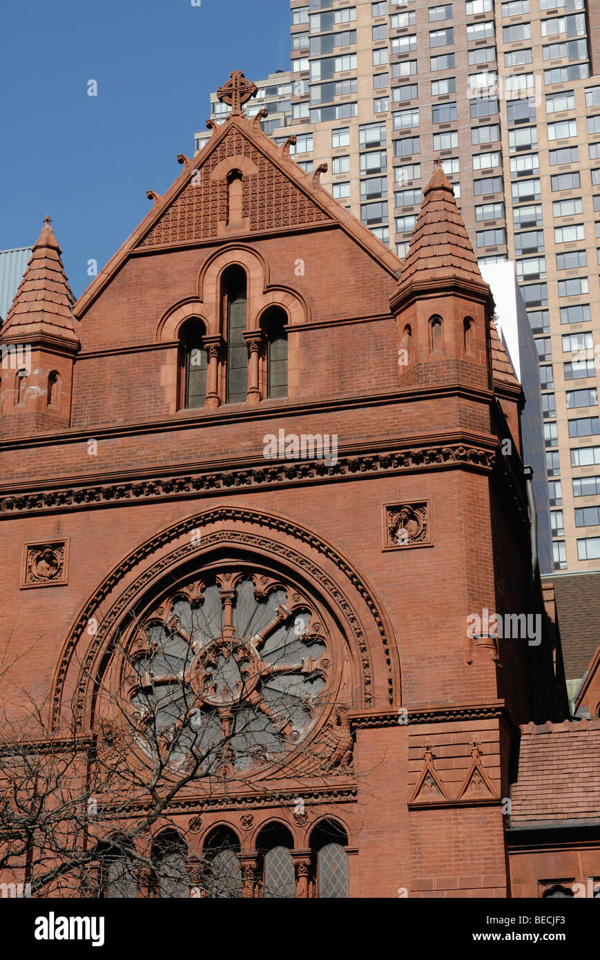 Old brick church in the 57th Street, modern multistory building in the back, New York, USA - Stock Image