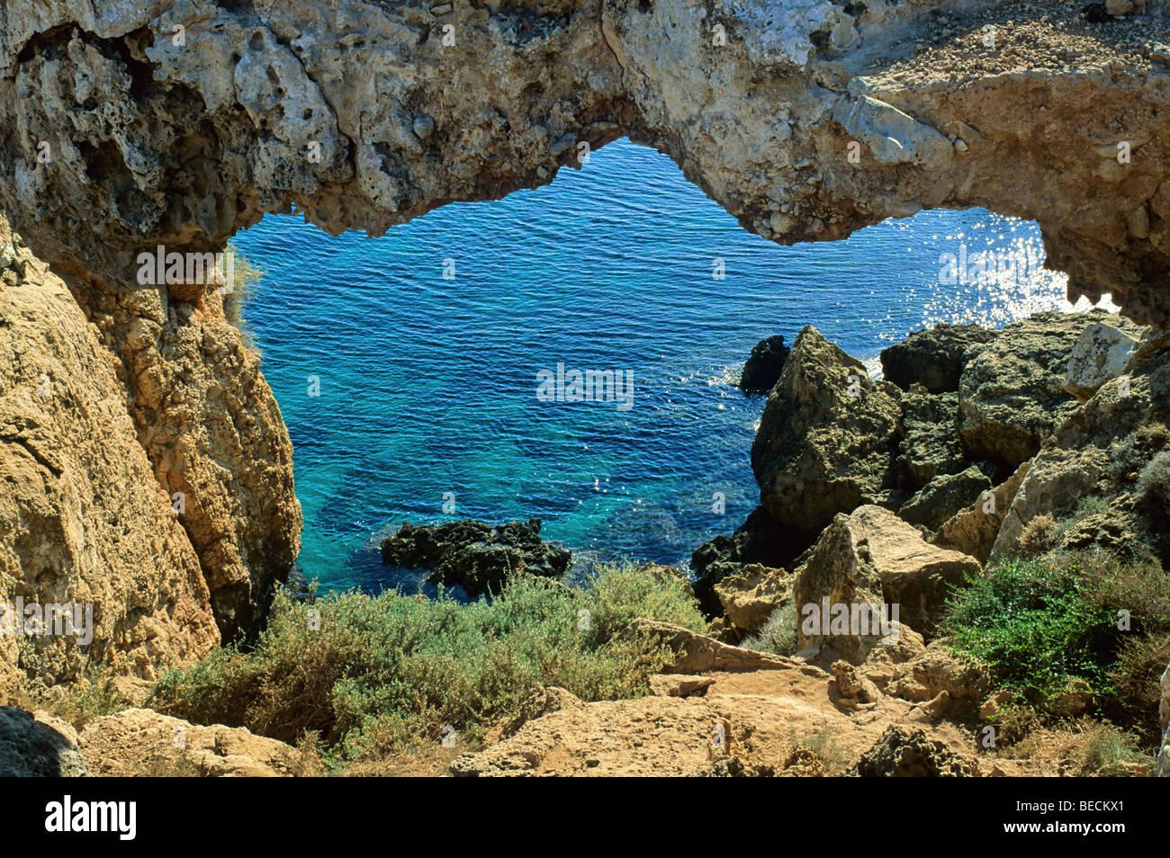 Rock arch near cape Gkreko, south east coast, Cyprus island, Greece - Stock Image