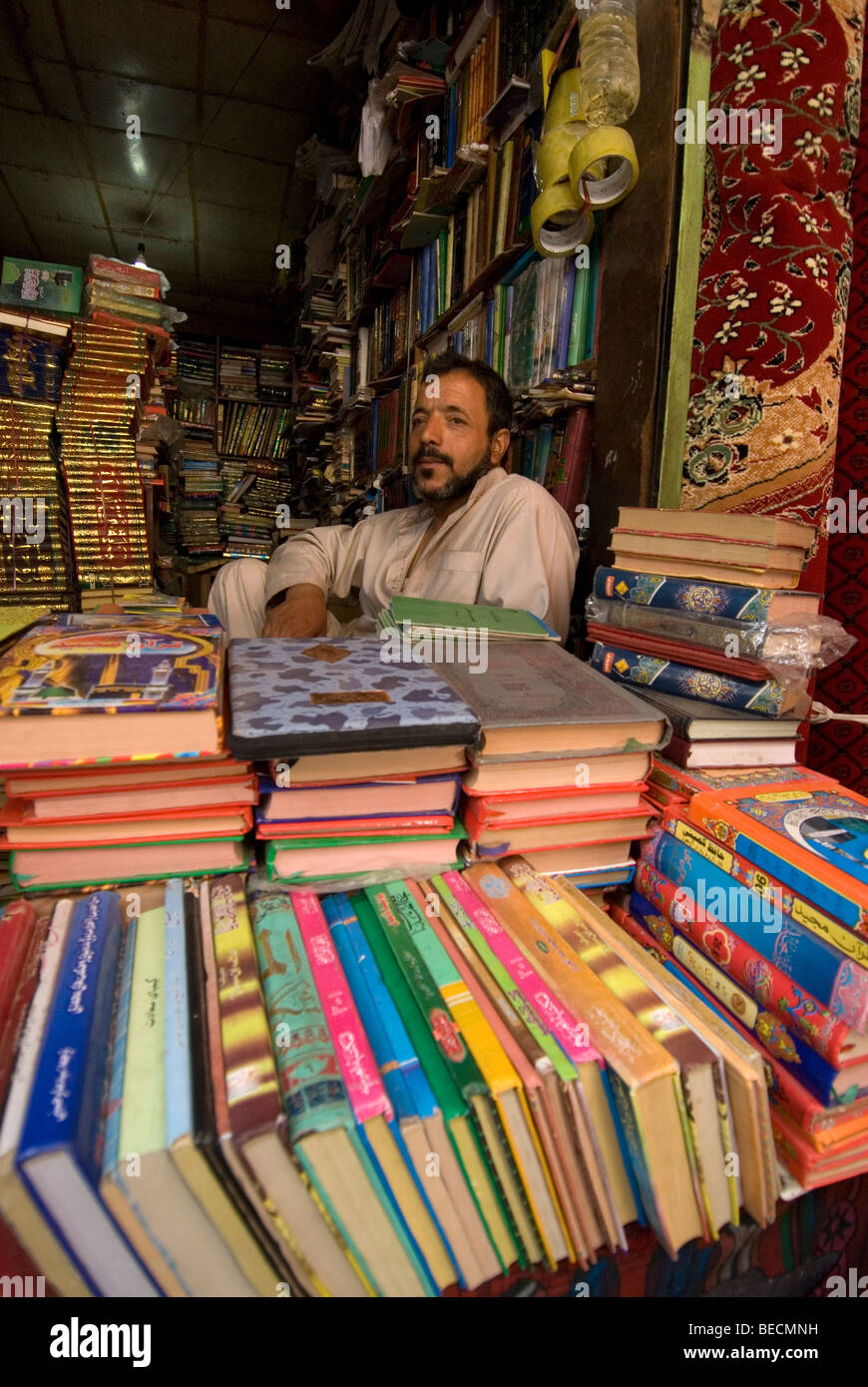 Afghanistan, Kabul. Central market. Bookseller sitting at his stall in the market. - Stock Image
